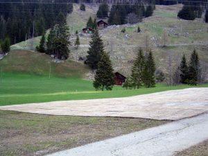 Berner Oberland Winter Parkplatz ecopark Holzrost
